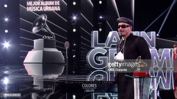 In this screengrab, J Balvin accepts the Best Urban Music Album award for 'Colores' during The 21st Annual Latin GRAMMY Awards at American Airlines...
