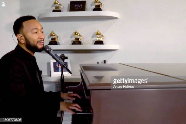 In this screengrab, John Legend attends MusiCares: Music On A Mission Online Celebration and Fundraiser during the 63rd Annual GRAMMY Awards on March...