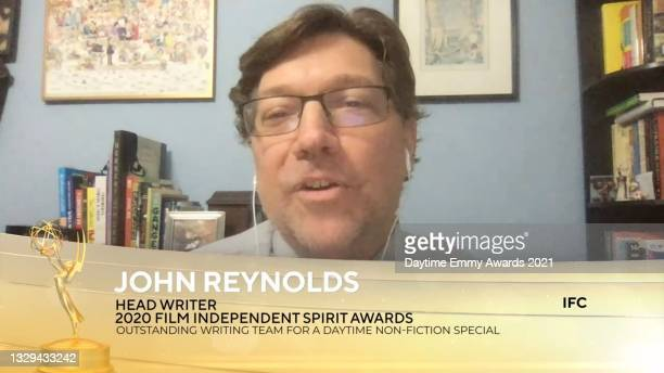 """In this screengrab, John Reynolds accepts the award for Outstanding Writing Team for a Daytime Non-Fiction Special for """"Jeopardy! The Greatest of All..."""