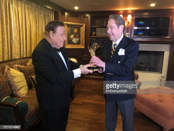 In this screengrab John Sterling recieves the NY NATAS Governor's award from NY NATAS Awards Chair Marvin Scott on camera during a livestream for the...