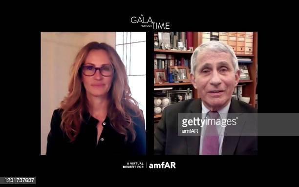 In this screengrab, Julia Roberts and Dr. Anthony Fauci participate in amfAR's A Gala For Our Time Virtual Event on March 4, 2021.