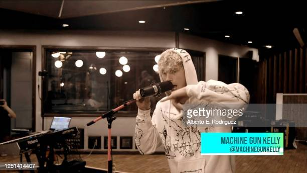 In this screengrab Machine Gun Kelly performs during the Riot Games MidSeason Streamathon to Raise Funds for Covid19 Relief on May 31 2020 in Various...