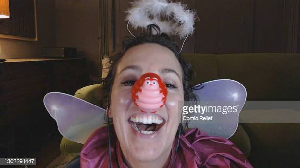 In this screengrab, Olivia Colman takes part in Red Nose Day 2021 by wearing the Caterpillar nose while playing the Fairy Godmother during the...