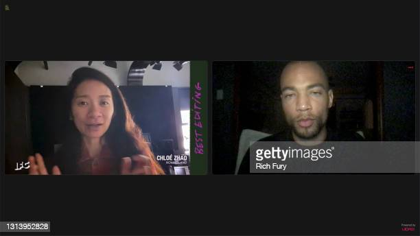 """In this screengrab released on April 22, Chloé Zhao, winner of Best Editing for """"Nomadland"""", with Kendrick Sampson, speaks during the 2021 Film..."""