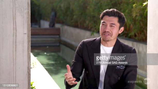 In this screengrab released on April 4 Henry Golding speaks during the 27th Annual Screen Actors Guild Awards on April 04, 2021.