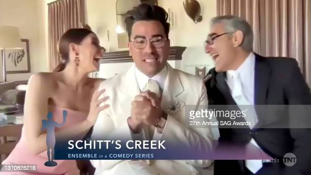 In this screengrab released on April 4 Sarah Levy, Dan Levy, and Eugene Levy, winners of Outstanding Performance by an Ensemble in a Comedy Series...