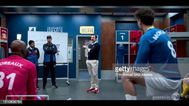 """In this screengrab released on April 4 the cast of """"Ted Lasso"""" perform as their characters during the 27th Annual Screen Actors Guild Awards on April..."""