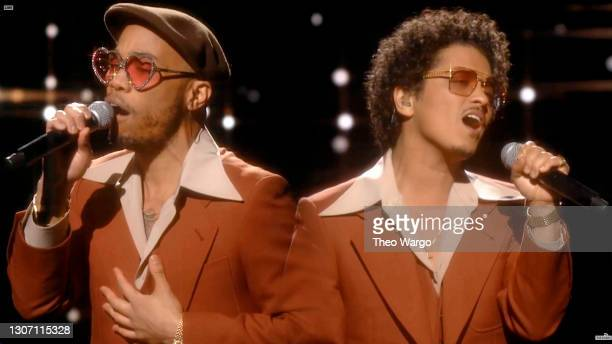 In this screengrab released on March 14, Anderson .Paak and Bruno Mars of music group Silk Sonic perform onstage during the 63rd Annual GRAMMY Awards...