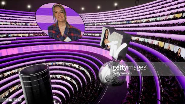 In this screengrab released on November 08, Karol G accepts the win for Best Latin from Winnie Harlow at the MTV EMA's 2020. The MTV EMA's aired on...