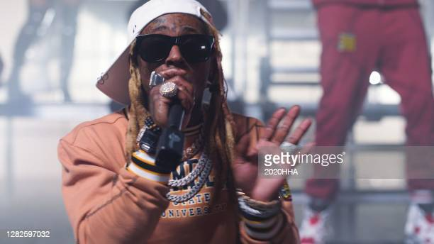 In this screengrab released on October 27, Lil Wayne and 2 Chainz perform for the BET Hip Hop Awards 2020.
