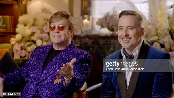 In this screengrab, Sir Elton John and David Furnish speak during the 29th Annual Elton John AIDS Foundation Academy Awards Viewing Party on April...