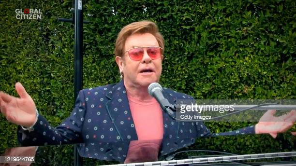 "In this screengrab, Sir Elton John performs during ""One World: Together At Home"" presented by Global Citizen on April 2020. The global broadcast and..."