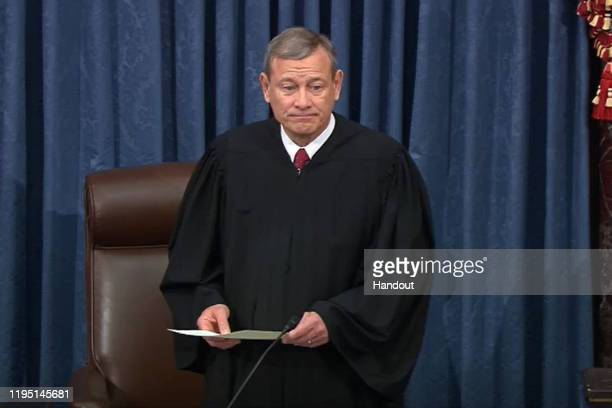 In this screengrab taken from a Senate Television webcast, Supreme Court Chief Justice John Roberts prepares to administer the oath to swear in U.S....