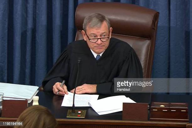 In this screengrab taken from a Senate Television webcast Supreme Court Chief Justice John Roberts presides over impeachment proceedings against US...