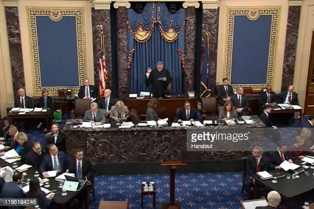 In this screengrab taken from a Senate Television webcast Supreme Court Chief Justice John Roberts administers the oath to Sen Jim Inhofe during...