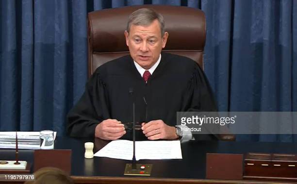 In this screengrab taken from a Senate Television webcast, Supreme Court Chief Justice John Roberts presides over impeachment proceedings against...
