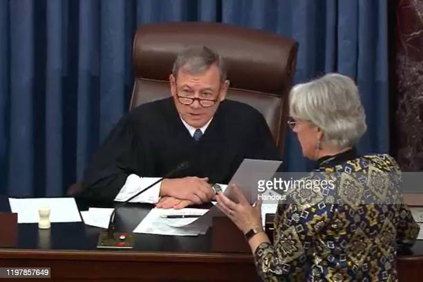 In this screengrab taken from a Senate Television webcast Supreme Court Chief Justice John Roberts announces a 5149 Senate vote defeating a motion to...