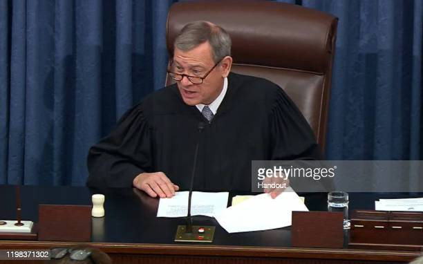 In this screengrab taken from a Senate Television webcast, Supreme Court Chief Justice John Roberts speaks during impeachment proceedings against...