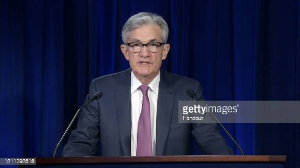 In this screengrab taken from the Federal Reserve website, Chair of the Federal Reserve Jerome Powell issues the Federal Open Market Committee...