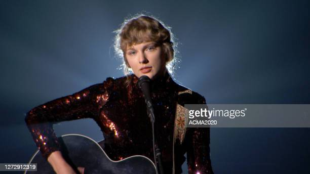 In this screengrab, Taylor Swift performs onstage during the 55th Academy of Country Music Awards at the Grand Ole Opry on September 16, 2020 in...