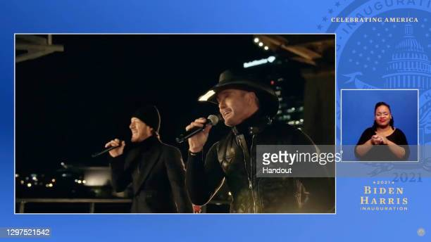In this screengrab, Tyler Hubbard and Tim McGraw perform during the Celebrating America Primetime Special on January 20, 2021. The livestream event...