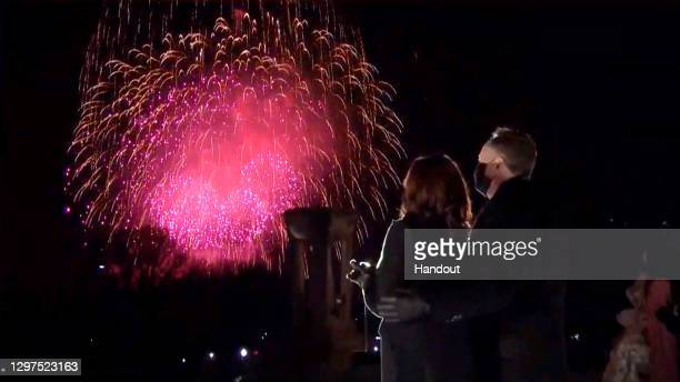 In this screengrab, Vice President Kamala Harris and Doug Emhoff watch fireworks during the Celebrating America Primetime Special on January 20,...