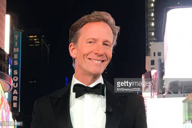 In this screengrab WABCTV Correspondent N J Burkett poses in Times Square during a livestream for the 63rd Annual Emmy Awards on April 25 2020 in New...