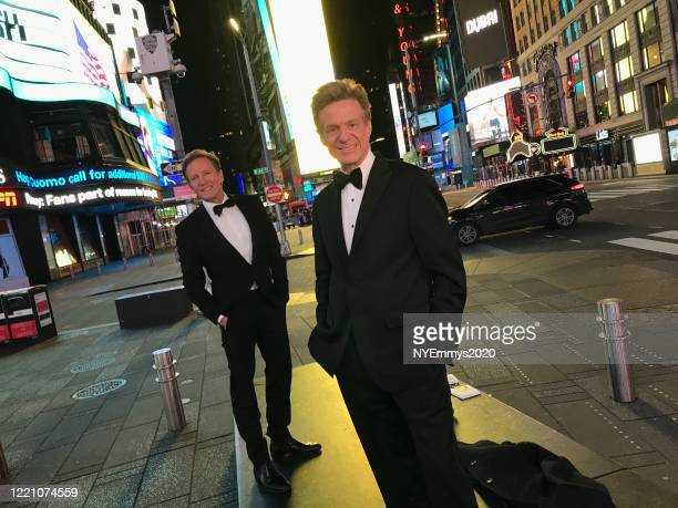 In this screengrab WABCTV Correspondents N J Burkett and Sandy Kenyon pose in Times Square during a livestream for the 63rd Annual Emmy Awards on...