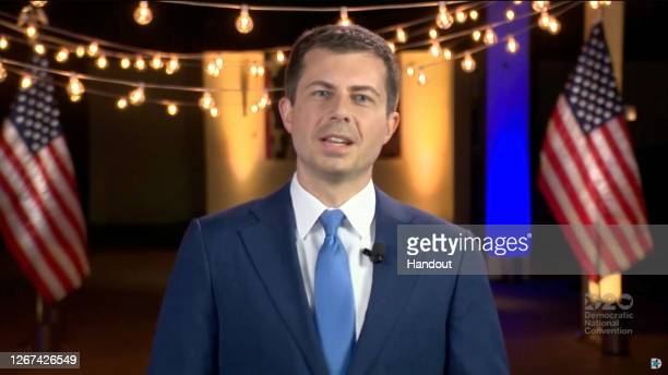 In this screenshot from the DNCC's livestream of the 2020 Democratic National Convention former Mayor of South Bend Indiana Pete Buttigieg addresses...
