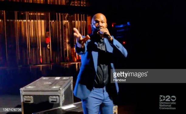 In this screenshot from the DNCC's livestream of the 2020 Democratic National Convention and subjected to publicist approval, Common performs to the...