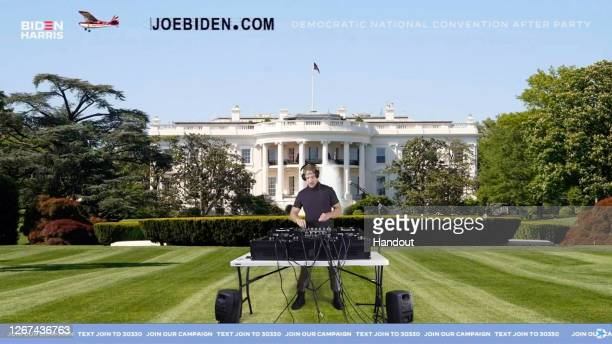 In this screenshot from the DNCC's livestream of the 2020 Democratic National Convention After Party, Diplo performs in front of a virtual background...