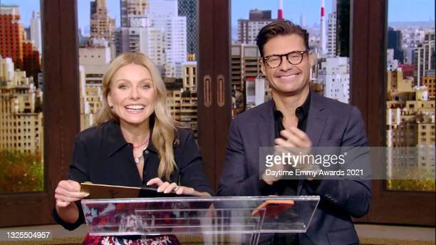 In this screenshot released on June 25, Kelly Ripa and Ryan Seacrest speak during the 48th Annual Daytime Emmy Awards broadcast on June 25, 2021.