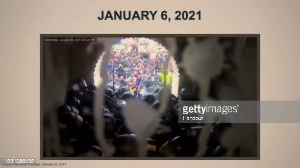 In this screenshot taken from a congress.gov webcast, House impeachment managers show video evidence of the January 6 mob breaching the U.S. Capitol,...