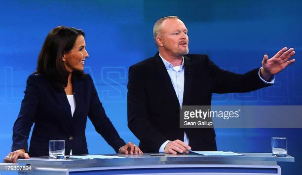In this screenshot taken from German television hosts Anne Will and Stefan Raab poses quations to German Chancellor and Christian Democrat Angela...