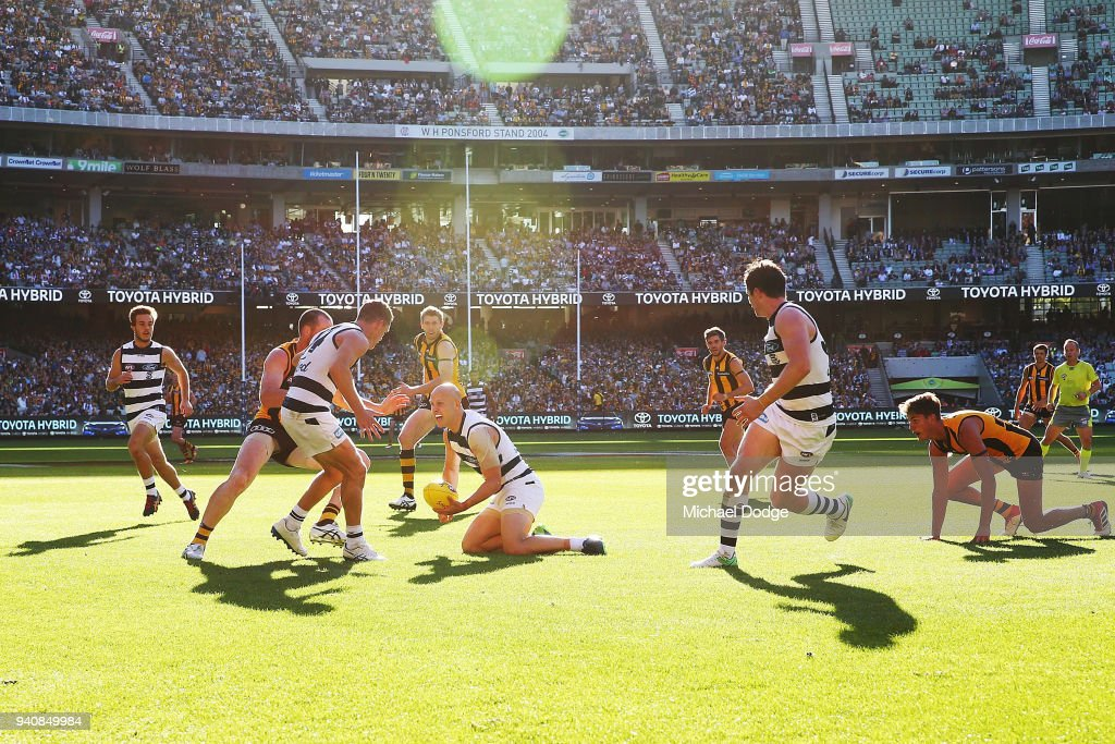 In this seen first time teammates together Joel Selwood of the Cats looks to handball to Gary Ablett as teammate (L) Patrick Dangerfield (R) looks on during the round two AFL match between the Geelong Cats and the Hawthorn Hawks at Melbourne Cricket Ground on April 2, 2018 in Melbourne, Australia.