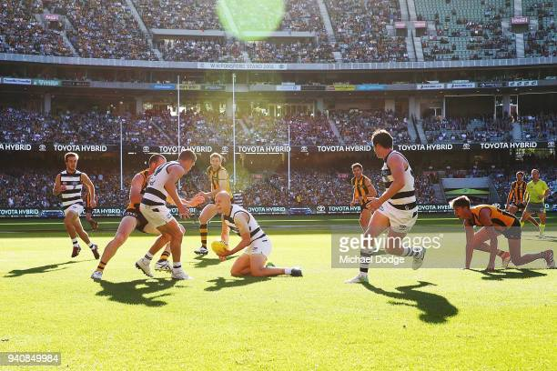 In this seen first time teammates together Joel Selwood of the Cats looks to handball to Gary Ablett as teammate Patrick Dangerfield looks on during...