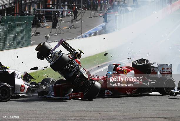 In this sequence of ten frames Romain Grosjean of France and Lotus is seen being catapulted into the air as he crashes at the first corner at the...