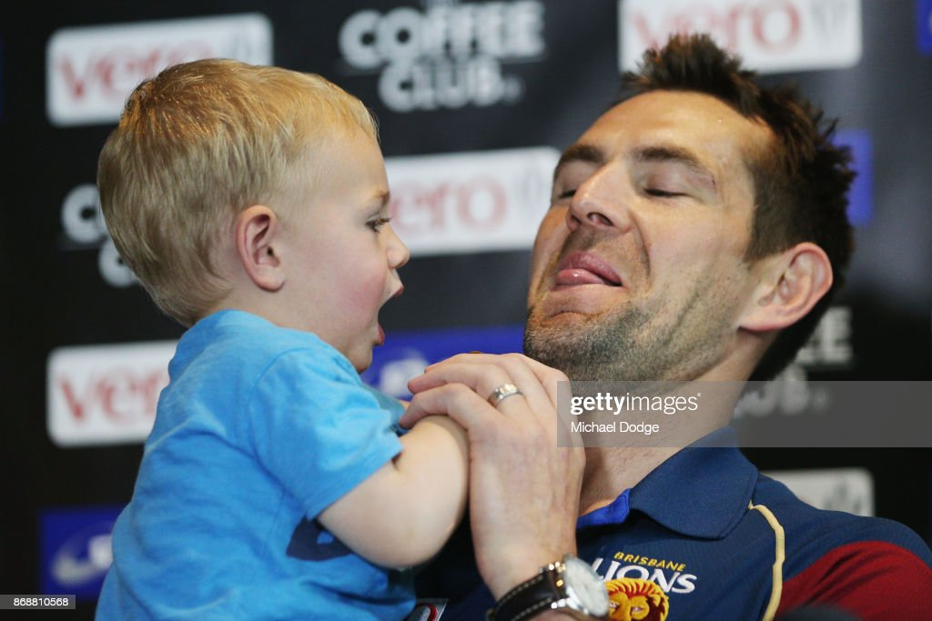 In this series Brisbane Lions recruit Luke Hodge is offered a lolipop by son Leo as he speaks to the media during a Brisbane Lions AFL media opportunity at WRAP on Southbank on November 1, 2017 in Melbourne, Australia.