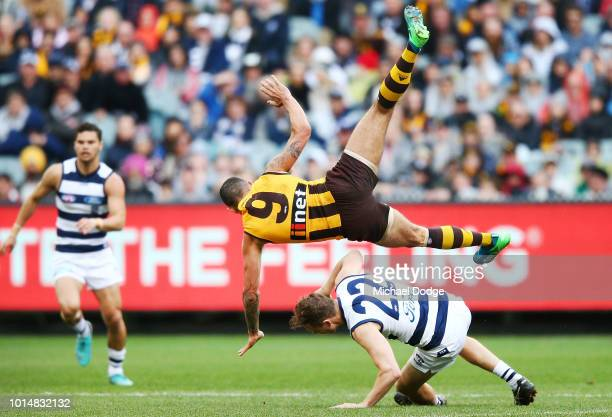In this series Shaun Burgoyne of the Hawks crashes over Mitch Duncan of the Cats in a contest during the round 21 AFL match between the Hawthorn...
