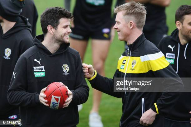 In this series Trent Cotchin reacts after listening carefully to Jack Riewoldt during a Richmond Tigers AFL training session at Punt Road Oval on...