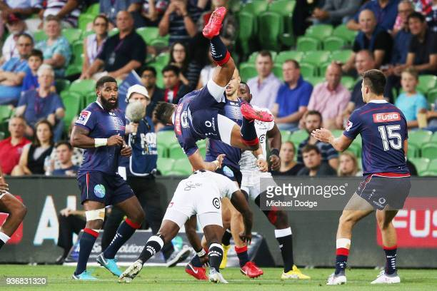In this series Will Genia of the Rebels crashes over the top when catching the ball during the round six Super Rugby match between the Melbourne...