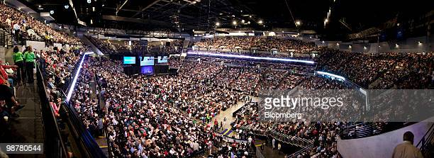 In this seven image composite shareholders gather prior to the start of the Berkshire Hathaway annual meeting in Omaha Nebraska US on Saturday May 1...