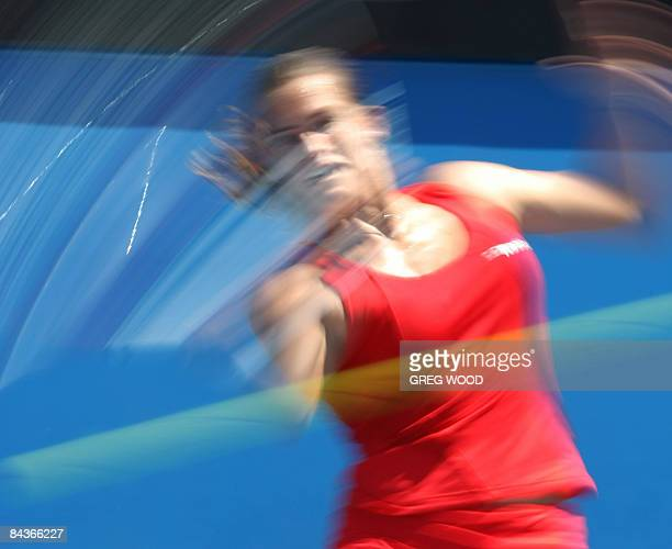 In this slow shutter photograph Amelie Mauresmo of France plays a shot against Olga Govortsova of the Ukraine during the second day of the Australian...
