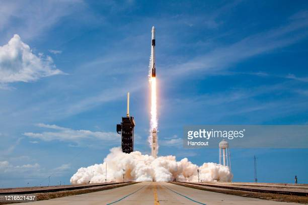 In this SpaceX handout image, a Falcon 9 rocket carrying the company's Crew Dragon spacecraft launches on the Demo-2 mission to the International...