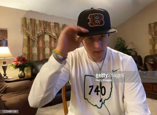 In this still image from video provided by the Cincinnati Bengals quarterback Joe Burrow speaks via teleconference after being selected during the...