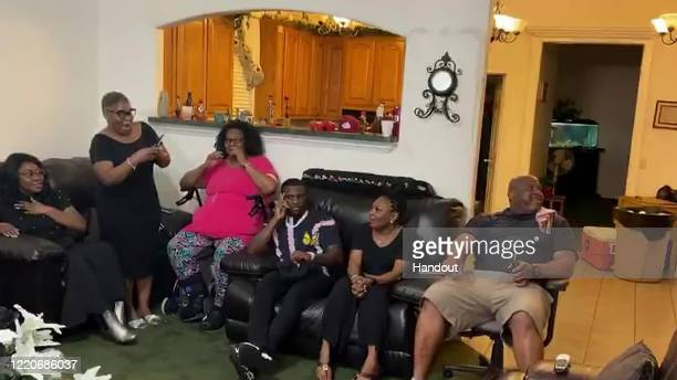 In this still image from video provided by the NFL Jalen Reagor center reacts during the first round of the 2020 NFL Draft on April 23 2020 Reagor...