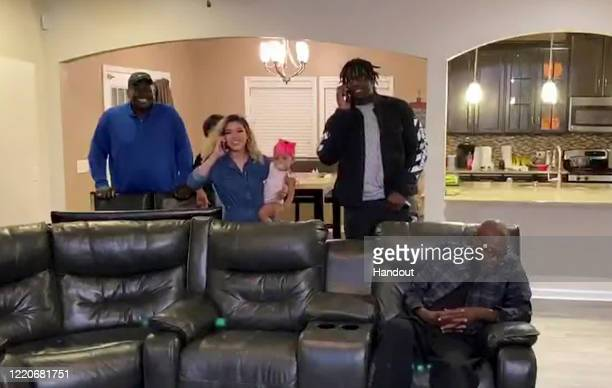 In this still image from video provided by the NFL Javon Kinlaw talks on a phone in Columbia SC during the first round of the 2020 NFL Draft on April...
