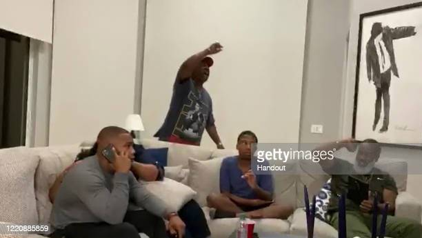 In this still image from video provided by the NFL JK Dobbins left talks on the phone as he's selected by the Baltimore Ravens during the second...