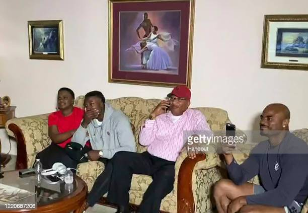 In this still image from video provided by the NFL Kenneth Murray in gray reacts during the first round of the 2020 NFL Draft on April 23 2020 Murray...