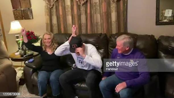 In this still image from video provided by the NFL LSU quarterback Joe Burrow puts on a Cincinnati Bengals cap after being selected first overall...